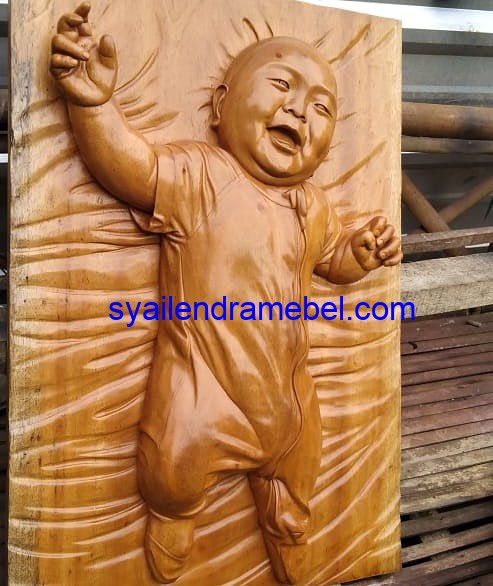 Relief Patung Babe
